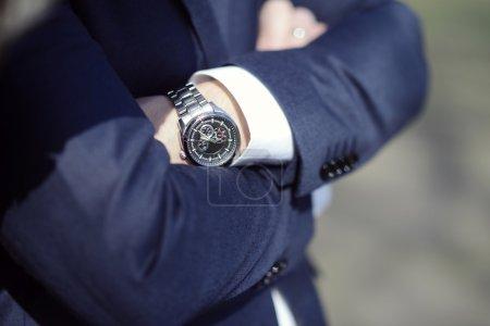 Groom wearing wrist watch