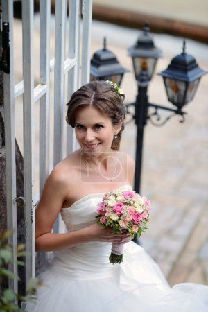 Beautiful bride in wedding dress with bouquet