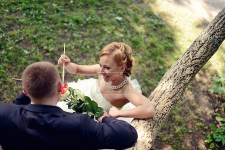 Beautiful wedding couple coloring flowers