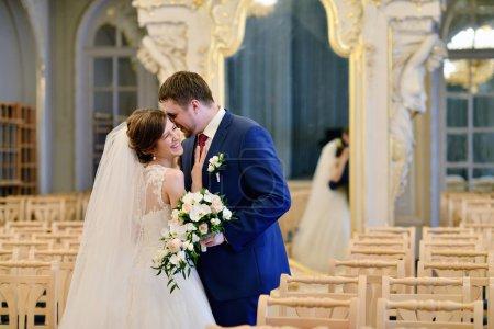 Beautiful wedding couple in elegant interior