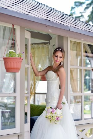 Beautiful bride in bridal gown with bouquet
