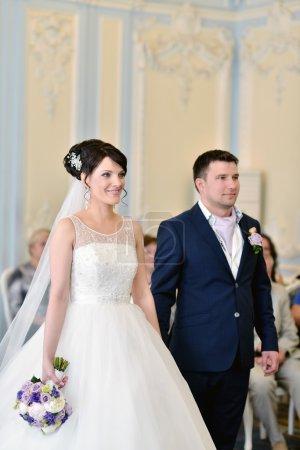 Beauty bride and groom registering marriage