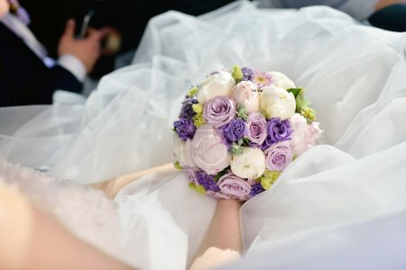 bride holding wedding colorful bouquet