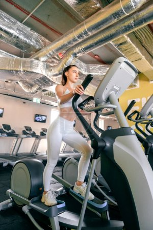 Photo for Young athlete woman cardio workout in gym - Royalty Free Image