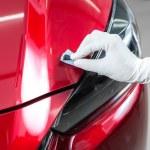 Closeup of hand coating car paint...