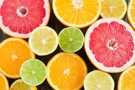 Photo for Summer super citrus mix of orange, lemon, lime, grapefruit. May be used as a background. shooting angle 90 degrees. - Royalty Free Image
