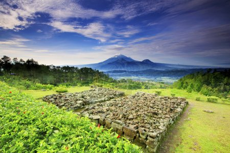 Photo for Gedong Songo (nine buildings), a group of small 8th century Hindu Javanese temples, can be reached either by car or on horseback from the town. Built at about the same time as the temples of the Dieng complex, - Royalty Free Image