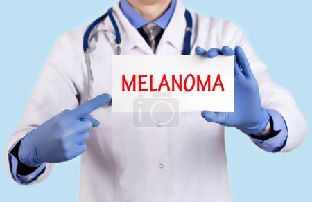 Doctor keeps a card with the name of the diagnosis - melanoma