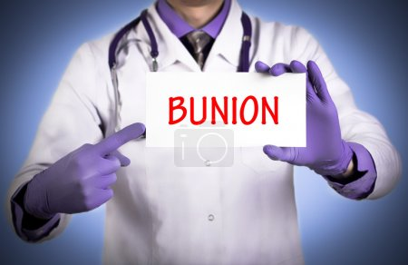 Doctor keeps a card with the name of the diagnosis - bunion