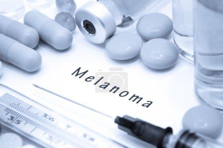 Melanoma - diagnosis written on a white piece of paper
