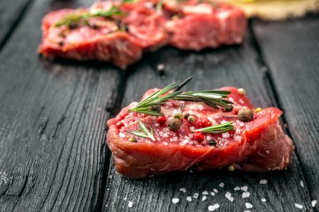 Photo for Raw beef steak and spices - Royalty Free Image
