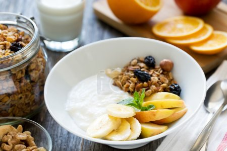 Photo for Healthy breakfast bowl with yogurt, fruits and granola - Royalty Free Image