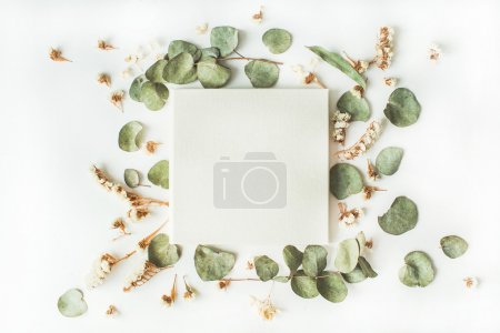 Photo for White wedding or family photo album, frame with dry and fresh branches isolated on white background. flat lay, overhead view - Royalty Free Image