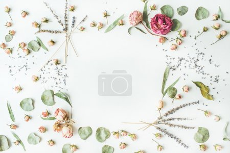 Frame with roses, lavender, branches, leaves and petals isolated on white background. flat lay, overhead view