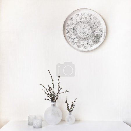 Photo for Branches of pussy-willows in white vase at white table and white vintage tray - Royalty Free Image