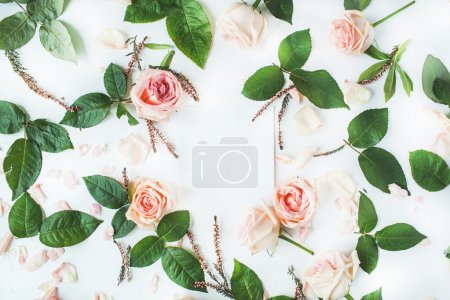 Photo for Empty paper blank with pink roses on white background. Flat lay, top view - Royalty Free Image