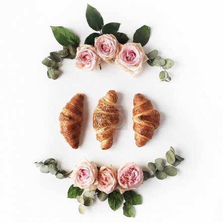Photo for Breakfast with croissants, pink rose flowers, petals composition. Flat lay, top view - Royalty Free Image