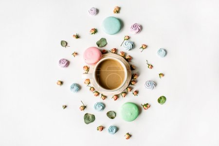 Photo for Cup of coffee with milk and macarons on white background. Flat lay, top view - Royalty Free Image