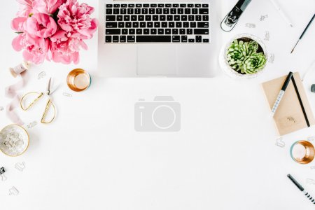 Photo for Workplace with laptop, succulent, peonies, golden scissors, spool with beige ribbon, pencils and diary. Flat lay composition for bloggers, magazines, social media and artists. Top view. - Royalty Free Image