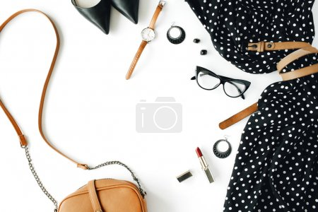 Photo for Flat lay feminine  clothes and accessories collage with black dress, glasses, high heel shoes, purse, watch, mascara, lipstick, earrings on white background. - Royalty Free Image