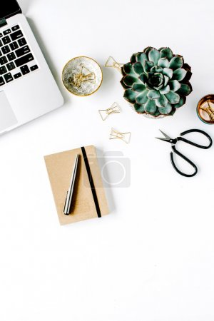 Photo for Feminine desk workspace with succulent, laptop, scissors, diary and golden clips on white background. flat lay, top view - Royalty Free Image