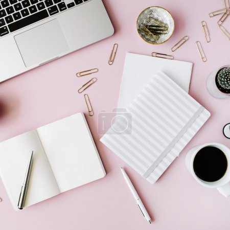 Photo for Flat lay, top view office table desk. feminine desk workspace with succulent, laptop, glasses, diary and golden clips on pink background. - Royalty Free Image