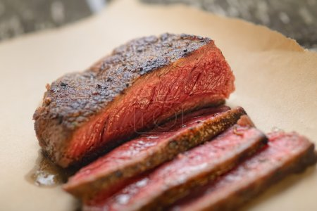 Photo for Sliced juicy tasty steak close-up - Royalty Free Image