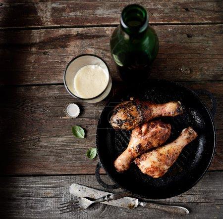 Fried chicken legs in a pan