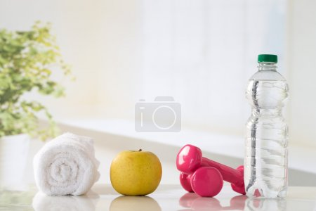 Photo for Fitness concept with water, accessories of musculation and fruit - Royalty Free Image