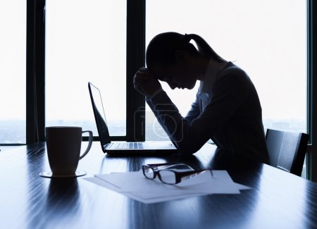 Photo for Silhouette of stressed business woman in the office. - Royalty Free Image