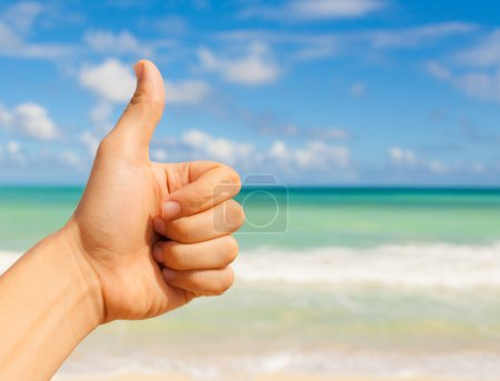 Thumbs up at the beach