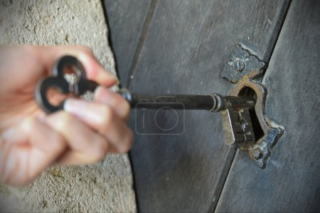 Key Being Inserted into a Door Lock