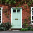 View of the Front Door of an Attractive Old Red Br...