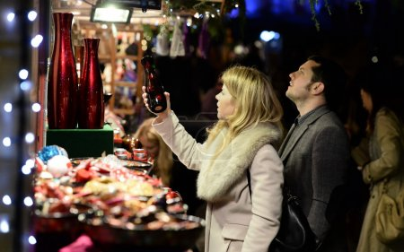People shop at the Christmas Market in the streets surrounding Bath Abbey