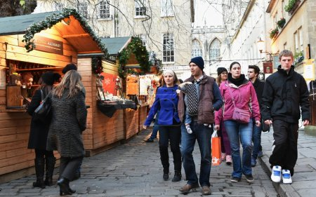People visit the Christmas Market in the streets surrounding Bath Abbey