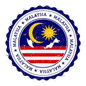 Malaysia map and flag in vintage rubber stamp of state colours