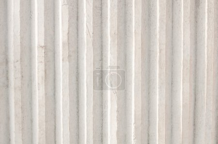 Ribbed cement wall white. Background. The texture of the concrete.