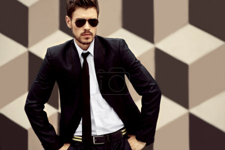 Young handsome men on creative background with sunglasses