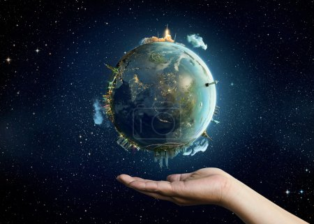 Photo for Planet Earth on palm. Elements of this image furnished by NASA - Royalty Free Image