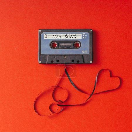 Vintage cassette tape on red background.