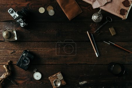 Photo for Flat lay of travel things on vintage wooden desk - Royalty Free Image
