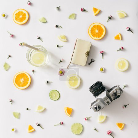 Colorful pattern made of citrus fruits and flowers. Flat lay