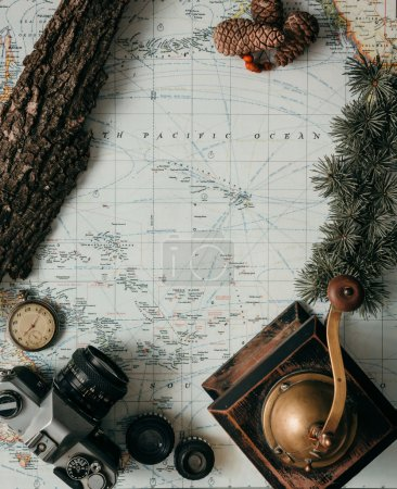 Photo for Flat lay adventure vintage gear for exploring or traveling on old map - Royalty Free Image