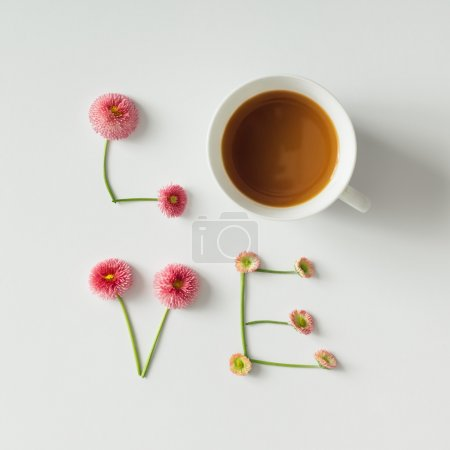 """Love"" made of flowers and coffee cup"