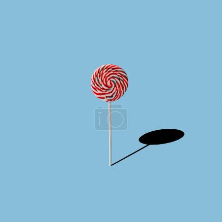Photo for Lollipop on blue background. Minimal concept - Royalty Free Image