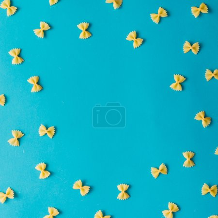 Photo for Pattern made of pasta on blue background. Flat lay. - Royalty Free Image