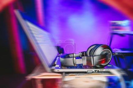 Dj laptop with headphones at nightclub