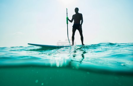 Photo for Stand up paddle board man paddleboarding . Young caucasian male model on Thailand beach on summer holidays vacation travel. - Royalty Free Image