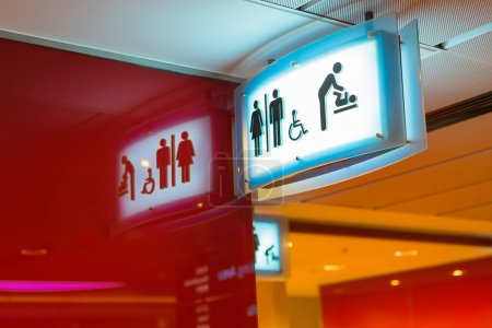 Photo for Toilets icon. Public restroom signs with a disabled access symbol. Interior of airport terminal. - Royalty Free Image
