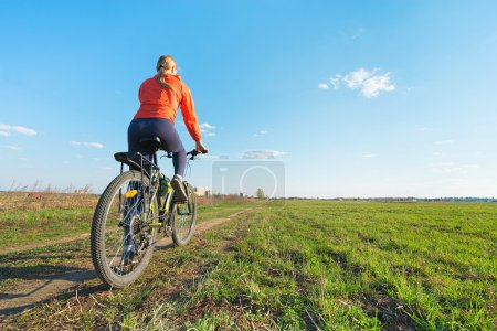 Young woman  ride on a bicycle